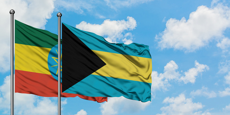 Ethiopia and Bahamas flag waving in the wind against white cloudy blue sky together. Diplomacy concept, international relations. Stock Photo - 123396670