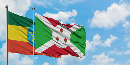 Ethiopia and Burundi flag waving in the wind against white cloudy blue sky together. Diplomacy concept, international relations.