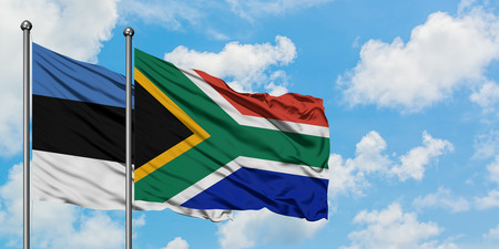 Estonia and South Africa flag waving in the wind against white cloudy blue sky together. Diplomacy concept, international relations.