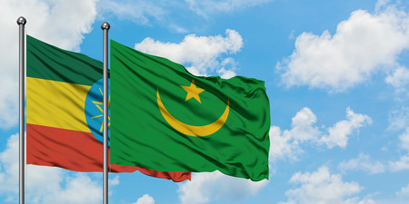 Ethiopia and Mauritania flag waving in the wind against white cloudy blue sky together. Diplomacy concept, international relations.