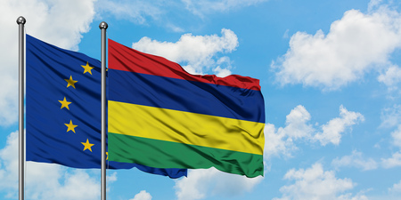 European Union and Mauritius flag waving in the wind against white cloudy blue sky together. Diplomacy concept, international relations.