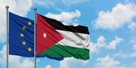 European Union and Jordan flag waving in the wind against white cloudy blue sky together. Diplomacy concept, international relations. 写真素材