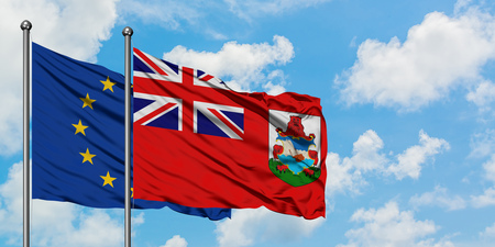 European Union and Bermuda flag waving in the wind against white cloudy blue sky together. Diplomacy concept, international relations.