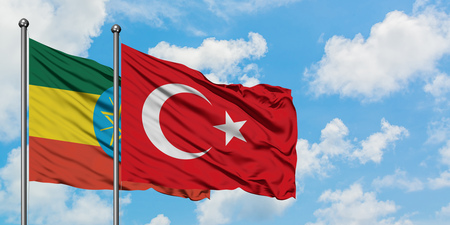 Ethiopia and Turkey flag waving in the wind against white cloudy blue sky together. Diplomacy concept, international relations. Stockfoto
