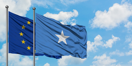 European Union and Somalia flag waving in the wind against white cloudy blue sky together. Diplomacy concept, international relations. Banque d'images