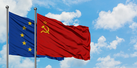 European Union and Soviet Union flag waving in the wind against white cloudy blue sky together. Diplomacy concept, international relations.