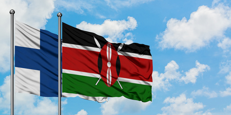 Finland and Kenya flag waving in the wind against white cloudy blue sky together. Diplomacy concept, international relations.