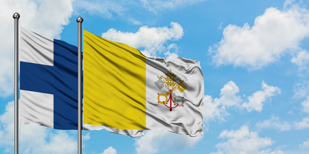 Finland and Vatican City flag waving in the wind against white cloudy blue sky together. Diplomacy concept, international relations.