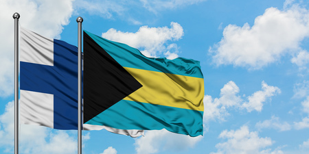 Finland and Bahamas flag waving in the wind against white cloudy blue sky together. Diplomacy concept, international relations. Stock Photo - 123444537