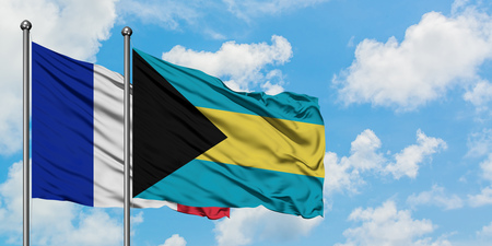 France and Bahamas flag waving in the wind against white cloudy blue sky together. Diplomacy concept, international relations. Stock Photo - 123464515