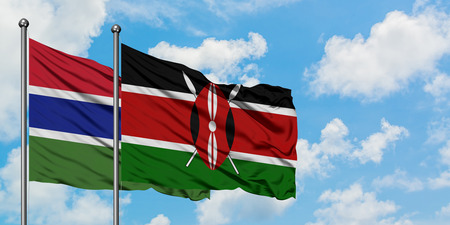 Gambia and Kenya flag waving in the wind against white cloudy blue sky together. Diplomacy concept, international relations.