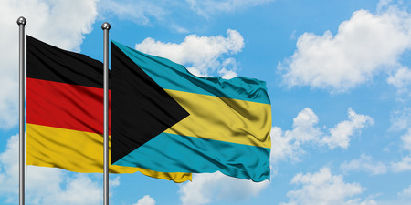 Germany and Bahamas flag waving in the wind against white cloudy blue sky together. Diplomacy concept, international relations. Stock Photo - 123555883