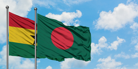 Ghana and Bangladesh flag waving in the wind against white cloudy blue sky together. Diplomacy concept, international relations.