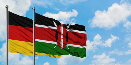Germany and Kenya flag waving in the wind against white cloudy blue sky together. Diplomacy concept, international relations.