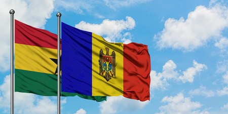 Ghana and Moldova flag waving in the wind against white cloudy blue sky together. Diplomacy concept, international relations.