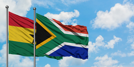 Ghana and South Africa flag waving in the wind against white cloudy blue sky together. Diplomacy concept, international relations.