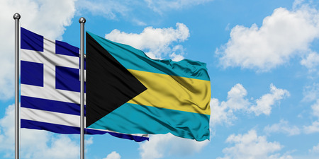 Greece and Bahamas flag waving in the wind against white cloudy blue sky together. Diplomacy concept, international relations. Stock Photo - 123581006
