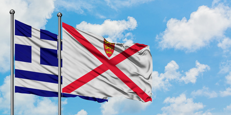 Greece and Jersey flag waving in the wind against white cloudy blue sky together. Diplomacy concept, international relations.