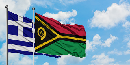Greece and Vanuatu flag waving in the wind against white cloudy blue sky together. Diplomacy concept, international relations.