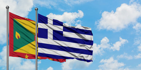 Grenada and Greece flag waving in the wind against white cloudy blue sky together. Diplomacy concept, international relations.