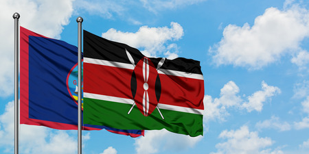 Guam and Kenya flag waving in the wind against white cloudy blue sky together. Diplomacy concept, international relations.