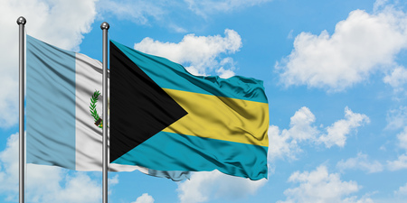 Guatemala and Bahamas flag waving in the wind against white cloudy blue sky together. Diplomacy concept, international relations. Stock Photo - 123587989