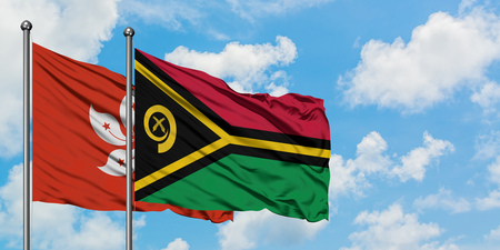 Hong Kong and Vanuatu flag waving in the wind against white cloudy blue sky together. Diplomacy concept, international relations.