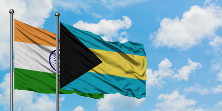 India and Bahamas flag waving in the wind against white cloudy blue sky together. Diplomacy concept, international relations. Stock Photo - 123698559