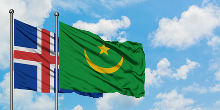 Iceland and Mauritania flag waving in the wind against white cloudy blue sky together. Diplomacy concept, international relations.