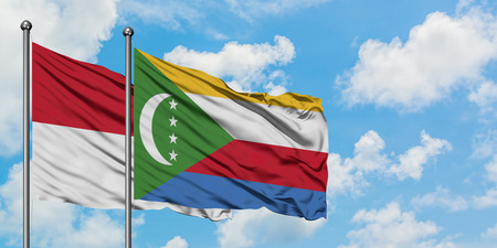 Iraq and Comoros flag waving in the wind against white cloudy blue sky together. Diplomacy concept, international relations. Stockfoto