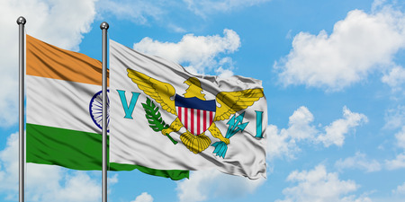 India and United States Virgin Islands flag waving in the wind against white cloudy blue sky together. Diplomacy concept, international relations. Stock Photo