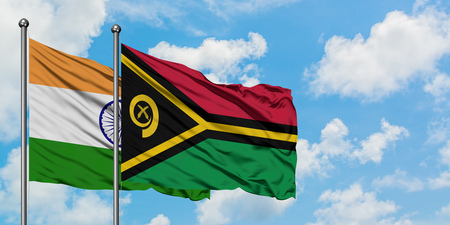 India and Vanuatu flag waving in the wind against white cloudy blue sky together. Diplomacy concept, international relations.