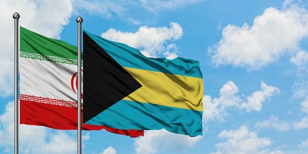 Iran and Bahamas flag waving in the wind against white cloudy blue sky together. Diplomacy concept, international relations. Stock Photo - 123690215