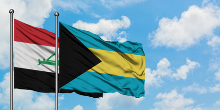 Iraq and Bahamas flag waving in the wind against white cloudy blue sky together. Diplomacy concept, international relations. Stock Photo - 123690318