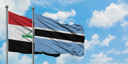 Iraq and Botswana flag waving in the wind against white cloudy blue sky together. Diplomacy concept, international relations.