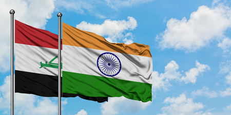 Iraq and India flag waving in the wind against white cloudy blue sky together. Diplomacy concept, international relations.