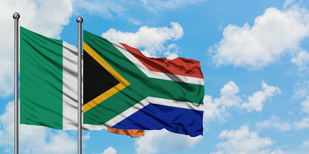 Ireland and South Africa flag waving in the wind against white cloudy blue sky together. Diplomacy concept, international relations.