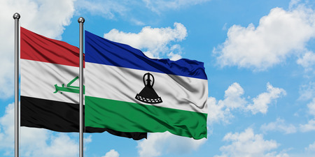Iraq and Lesotho flag waving in the wind against white cloudy blue sky together. Diplomacy concept, international relations.