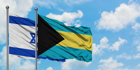 Israel and Bahamas flag waving in the wind against white cloudy blue sky together. Diplomacy concept, international relations. Stock Photo - 123732147