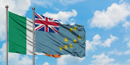 Ireland and Tuvalu flag waving in the wind against white cloudy blue sky together. Diplomacy concept, international relations. Stock Photo