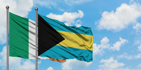Ireland and Bahamas flag waving in the wind against white cloudy blue sky together. Diplomacy concept, international relations. Stock Photo - 123732748