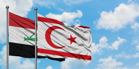 Iraq and Northern Cyprus flag waving in the wind against white cloudy blue sky together. Diplomacy concept, international relations.