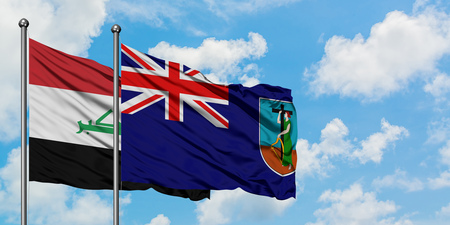 Iraq and Montserrat flag waving in the wind against white cloudy blue sky together. Diplomacy concept, international relations. Stock Photo