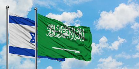 Israel and Saudi Arabia flag waving in the wind against white cloudy blue sky together. Diplomacy concept, international relations. Stock Photo