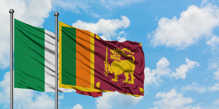 Italy and Sri Lanka flag waving in the wind against white cloudy blue sky together. Diplomacy concept, international relations.
