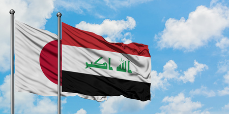 Japan and Iraq flag waving in the wind against white cloudy blue sky together. Diplomacy concept, international relations. Reklamní fotografie