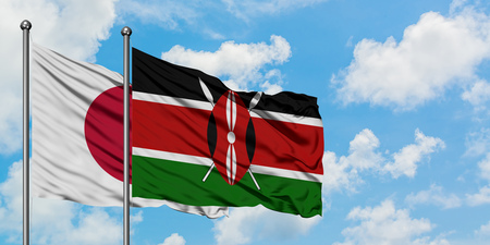 Japan and Kenya flag waving in the wind against white cloudy blue sky together. Diplomacy concept, international relations. Stock Photo
