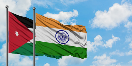 Jordan and India flag waving in the wind against white cloudy blue sky together. Diplomacy concept, international relations.