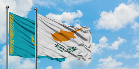 Kazakhstan and Cyprus flag waving in the wind against white cloudy blue sky together. Diplomacy concept, international relations. Standard-Bild