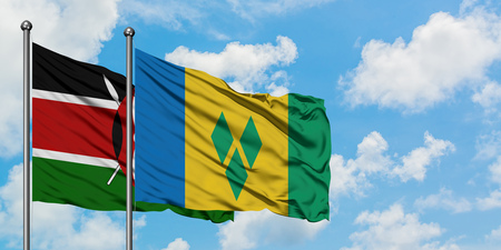 Kenya and Saint Vincent And The Grenadines flag waving in the wind against white cloudy blue sky together. Diplomacy concept, international relations.